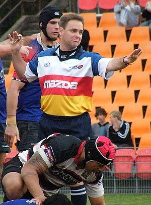 Rugby union match officials - Referee signalling a knock-on