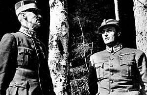 Per Bratland - Per Bratland's iconic photograph of King Haakon VII and Crown Prince Olav seeking shelter under the birch tree during a German bombing raid in April 1940