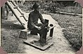 Kwijau woman at Keningau cutting tobacco on a chinese type of bench (7930191024).jpg