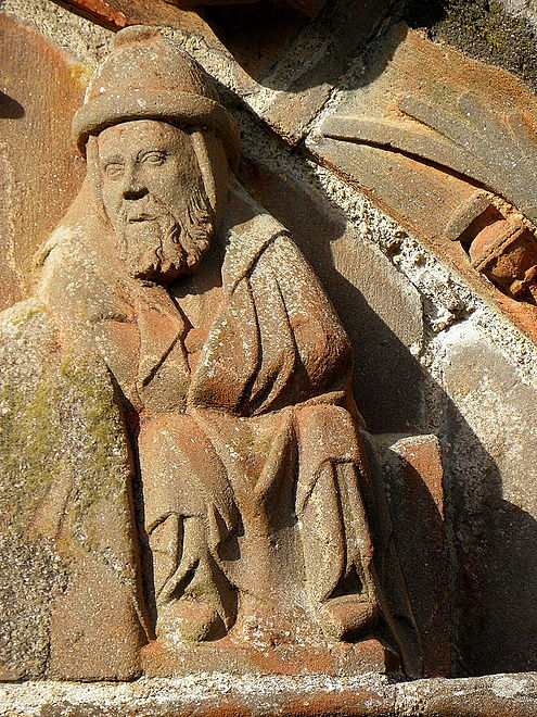 Joseph in the nativity scene in the tympanum over the south porch. He sits at the foot of the Virgin Mary's bed