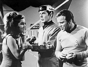 Spock's Brain - On Kirk's command, Spock grabs Kara's wrist to deactivate her bracelet.