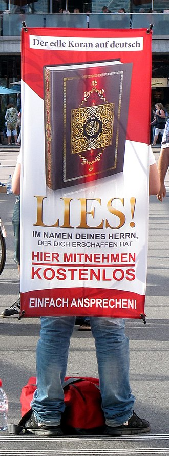 Proselytism - Proselytizer distributing copies of the Qur'an in Switzerland. (Lies! is German for Read!)