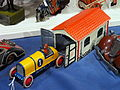 Litho tin toy yellow racecar Galop with garage.JPG