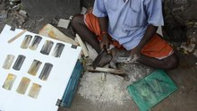 File:Local artisan cutting and filing animal horn to make combs.webm
