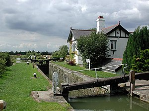 Lock (water navigation) - Canal lock and lock-keeper's cottage on the Aylesbury Arm of the Grand Union Canal at Marsworth in Hertfordshire, England