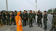 Lone monk at Wat Phra Dhammakaya during article 44.jpg