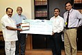 M. Veerappa Moily receiving a cheque from the CMD, GAIL, Shri B.C. Tripathi, towards the Prime Minister's National Relief Fund for relief and rehabilitation of Uttarakhand flood victims, in New Delhi. The Secretary.jpg