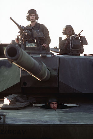 M240 machine gun - An M1 Abrams tank with the tank commander's .50-caliber M2 Browning machine gun on the right side of the tank, and the ammunition loader's M240 on the left side of the tank.