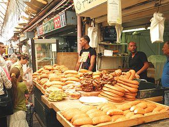 Mahane Yehuda Market - Bread and pita vendor.