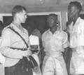 Maj. John Hasek (left).png