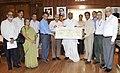 Mallikarjun Kharge receiving a cheque of Rs. One crore from the Chairman cum Managing Director, Rail Vikas Nigam Ltd. (RVNL), Shri Satish Agnihotri.jpg