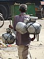 Man Bearing Metal Jugs - Chittagong - Bangladesh (13058479214).jpg