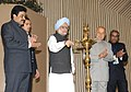Manmohan Singh lighting the lamp to inaugurate the National Energy Conservation Day function, in New Delhi. The Union Power Minister, Shri Sushil Kumar Shinde and the Minister of State for Power.jpg