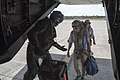 Marine helps members of the media onto an MV-22 Osprey. (37457299845).jpg