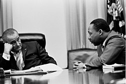 President Johnson meets with Civil Rights leader Martin Luther King in the White House Cabinet Room in 1966.