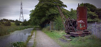 Derelict Smith (Rodley) crane, on the Manchester Bolton & Bury Canal Mbb canal steam crane sion.jpg