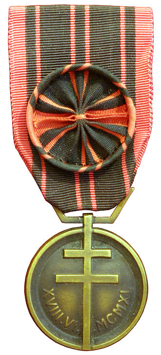 Rosette (decoration) - Médaille de la Résistance with a large rosette attached to the medal's suspension ribbon.  Smaller rosettes are usually worn separately.
