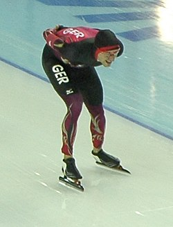 Men's 10000 m, 2014 Winter Olympics, Alexej Baumgärtner (cropped).JPG