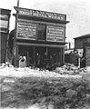 Men standing outside Dawson Sheet Metal Works, April 1908 (AL+CA 562).jpg