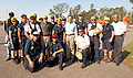 Michael Brown and Michael Chertoff pose with FEMA Urban Search and Rescue.jpg