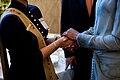 Michelle Obama greets a survivor of the 2008 Mumbai attacks.jpg