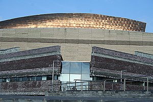 Jonathan Adams (architect) - Wales Millennium Centre, slate, timber and copper cladding