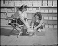 Minidoka Relocation Center. Betty Yasunobu, Nellie Arai, salesgirl. Selling skates in Community st . . . - NARA - 536574.tif