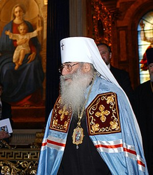Metropolitan bishop - Metropolitan Vladimir of Saint Petersburg wearing the light blue mandyas of a Russian Orthodox metropolitan.