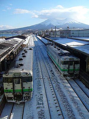Mori, Hokkaido - Mori Station with Mount Komagatake in the background