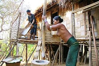 Mru people (Mrucha) - Mru women working in a village in Bangladesh. One of them is wearing traditional clothing.