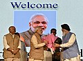 Narendra Modi being welcomed by the Governor of Punjab and Administrator of Chandigarh, Shri V.P. Singh Badnore and the Chief Minister of Punjab, Shri Parkash Singh Badal at the National MSME Awards ceremony.jpg