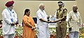 Narendra Modi giving away awards to the winners of national essay, painting and film competitions (6).jpg