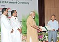 Narendra Modi presenting the Chaudhary Charan Singh Award for Excellence in Journalism in Agricultural Research and Development 2013 to the Shri Bhagwan Das, Patiala.jpg