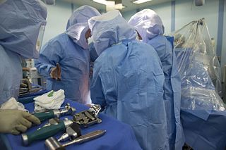 File:Navy doctors from USNS Mercy perform joint replacement