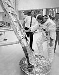 Neil Armstrong at the foot of the ladder on a LM mock-up during training.jpg