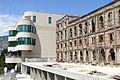 New Building alongside War Ruin - Mostar - Bosnia and Herzegovina.jpg