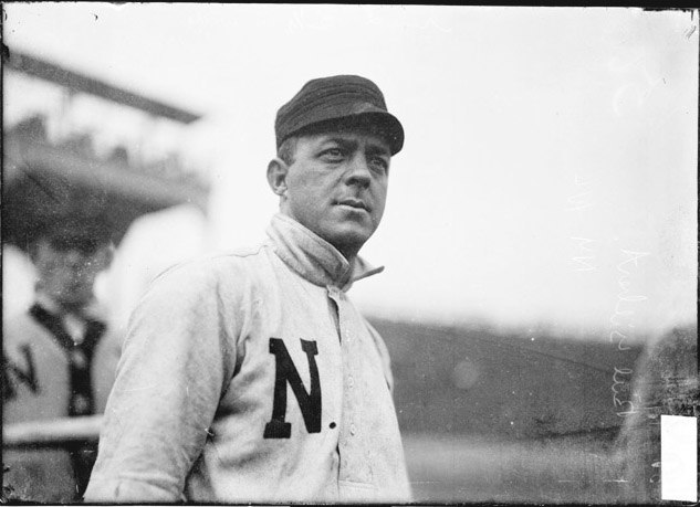 New York Giants second baseman Billy Gilbert, standing on the field at West Side Grounds
