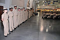Newly pinned U.S. Navy chief petty officers (CPO) stand at the position of at ease during a CPO pinning ceremony inside the USS Midway Ceremonial Drill Hall at Recruit Training Command at Naval Station Great 120914-N-IK959-766.jpg