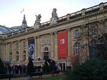 The Grand Palais of Paris is seen with a large Nintendo Switch banner advertisement hanging from it.