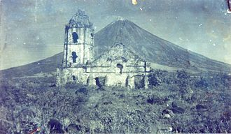 Mayon - An old photograph of the Cagsawa ruins with the façade still standing. The church was largely destroyed during the 1814 eruption of Mayon. Only the bell tower exists today.