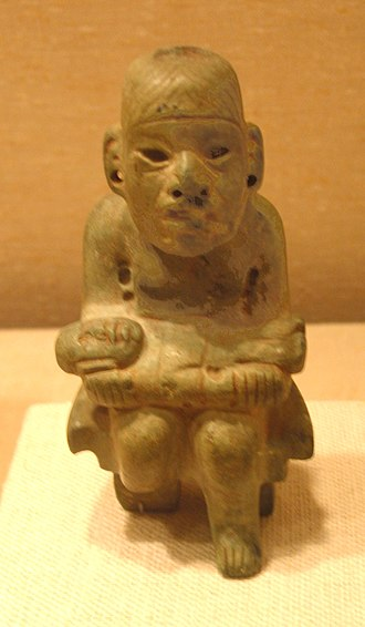 "Werejaguar - The ""presentation"" of an inert were-jaguar baby is a common theme in Olmec art. Compare this with Las Limas Monument 1 above."