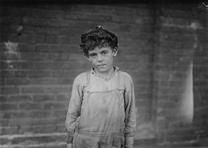 Pell City, Alabama - One of the young doffers working in Pell City Cotton Mill, 1910. Photo by Lewis Hine.