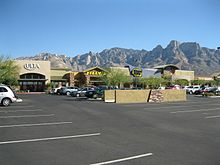 Photo shows Ulta, Tilly's and Best Buy stores at the Oro Valley Marketplace with Pusch Ridge rising in the background.