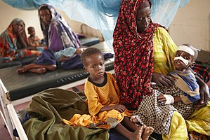 Poverty - Image: Oxfam East Africa Luli looks after her severely malnourished child Aden