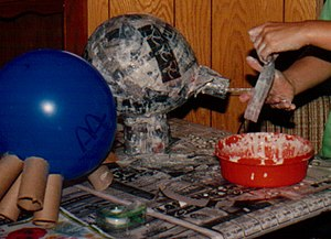 Papier-mâché - Papier-mâché with the strips method for the creation of a pig.