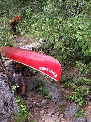 Portage - Canoes from Camp Pathfinder portaging in Algonquin Park