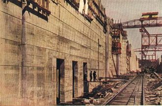 History of the Panama Canal - Pedro Miguel Locks under construction during the early 1910s, looking north, showing the center wall and intakes