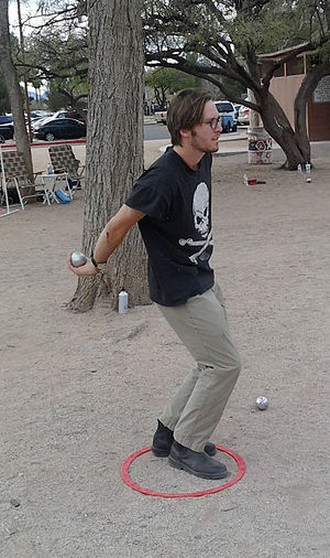 Pétanque - Pétanque player throwing from a prefabricated circle