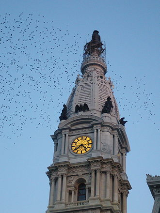 Gentrification in Philadelphia - Philadelphia City Hall, with statue of William Penn at top of tower
