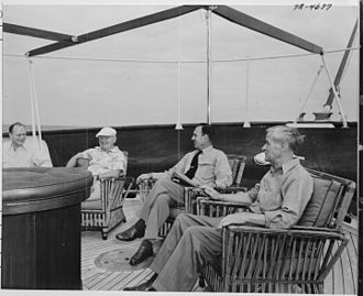 USS Williamsburg - President Truman on the afterdeck of the yacht, the U.S.S. WILLIAMSBURG, during a vacation in Key West, Florida: (left to right) Charles Murphy, Special Counsel to the President; President Truman; Admiral Robert Dennison, Naval Aide to the President; Charles Ross, Press Secretary.